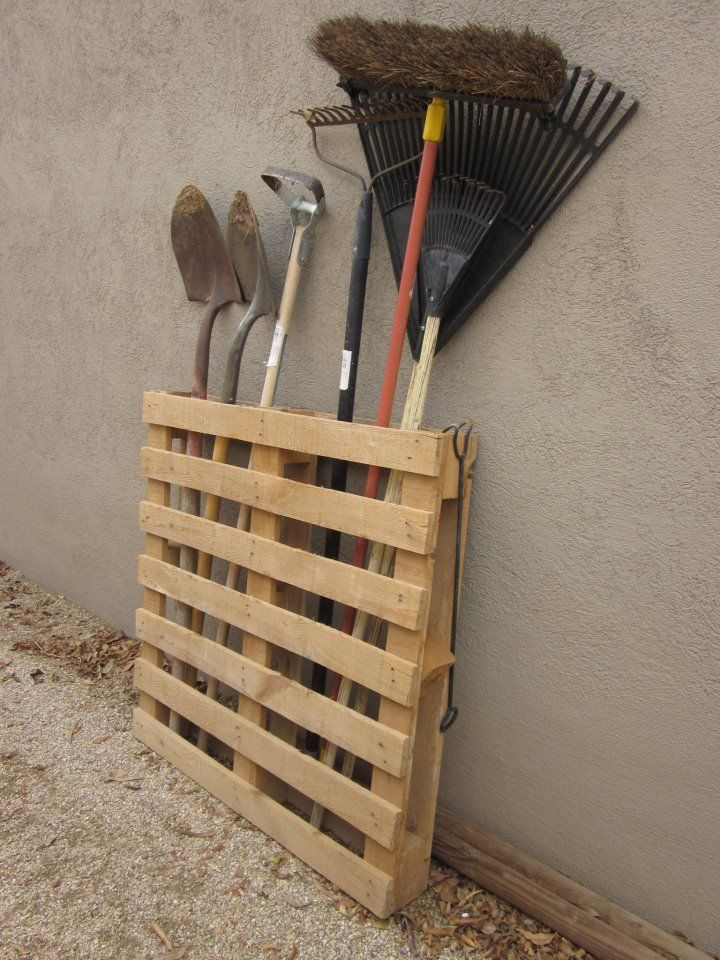Using ordinary pallets for gardening storage. I did this and I love it! I turned it the other side from picture shown, took out the second board down, to put shorter rakes shovels in! IM IN LOVE WITH MY NEW GARDEN TOOL RACK! I put all the tools in one side and my surplus wood for crafts in the other side! I killed 2 birds w/1 stone!!! lol