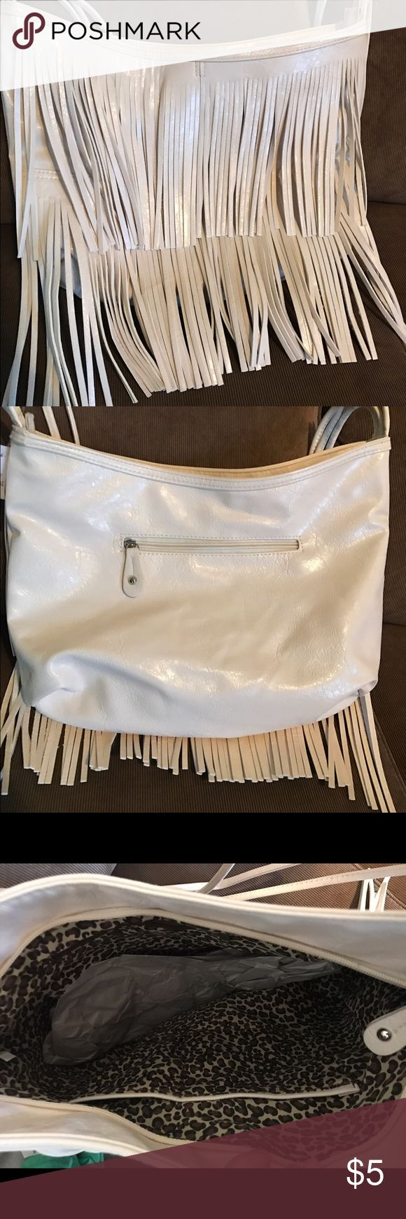 "Body Central white fringe purse NWT cream-colored fringe purse. 15"" wide around 11"" long. Let me know if you have any questions! Body Central Bags Shoulder Bags"