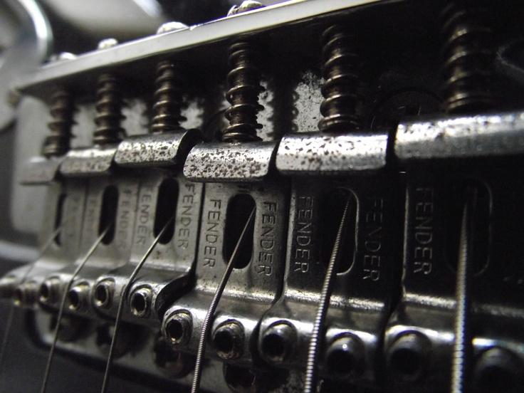Close up of a Fender bridge.