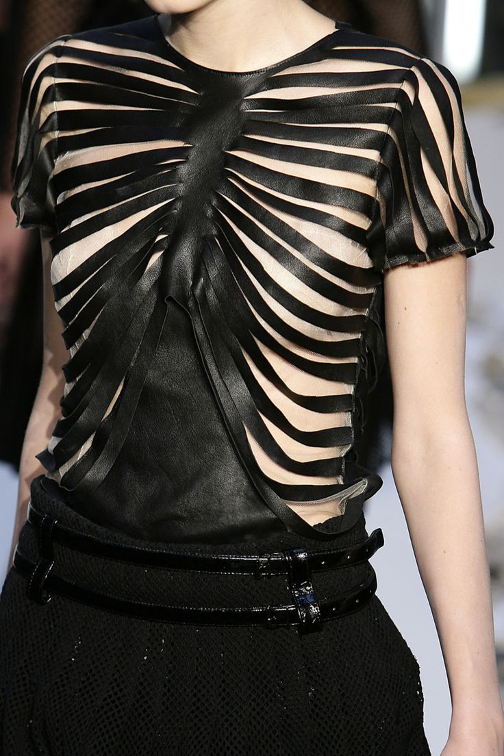Skeletal fashion details - soft draping leather top with bold skeleton inspired construction