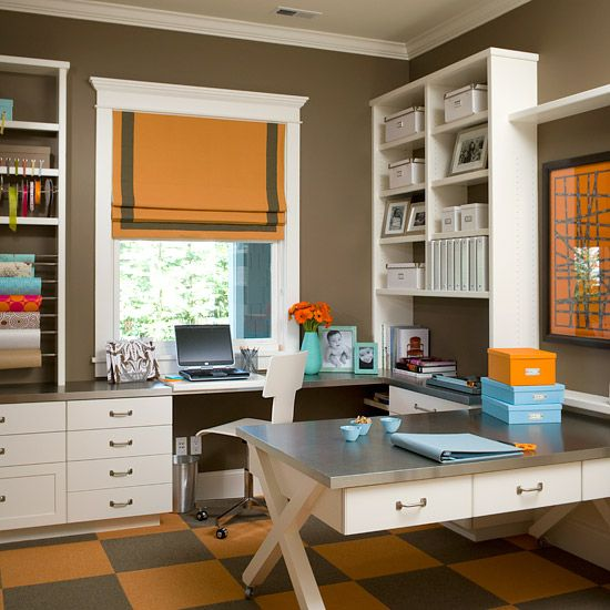 Office~ For a streamlined look, match your storage components to your shelving. These white boxes and baskets blend with the white shelving unit, creating a cohesive look that allows the room's sophisticated gray and orange elements to shine through. A coordinated look will keep large wall units from looking cluttered and disorganized.