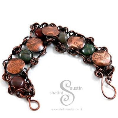 I had etched some of my doodles on a copper sheet and cut up the etched sheet into discs & gave them a gentle dome to make bracelet components. The etched copper circles were then joined together using 1mm pure copper wire swirls and Indian Agate disc shaped beads. Once fabricated the bracelet was given an antique patina which gives it a timeless feel.