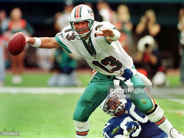 Miami Dolphins quarterback Dan Marino is sacked by Indianapolis Colts defensive end Mark Thomas during second quarter action of their game 05...
