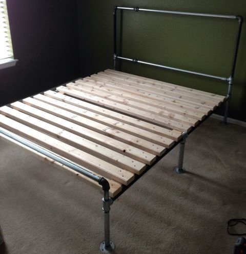 Legs were added to the bed frame and wooden slats were attached for the mattress to lay on