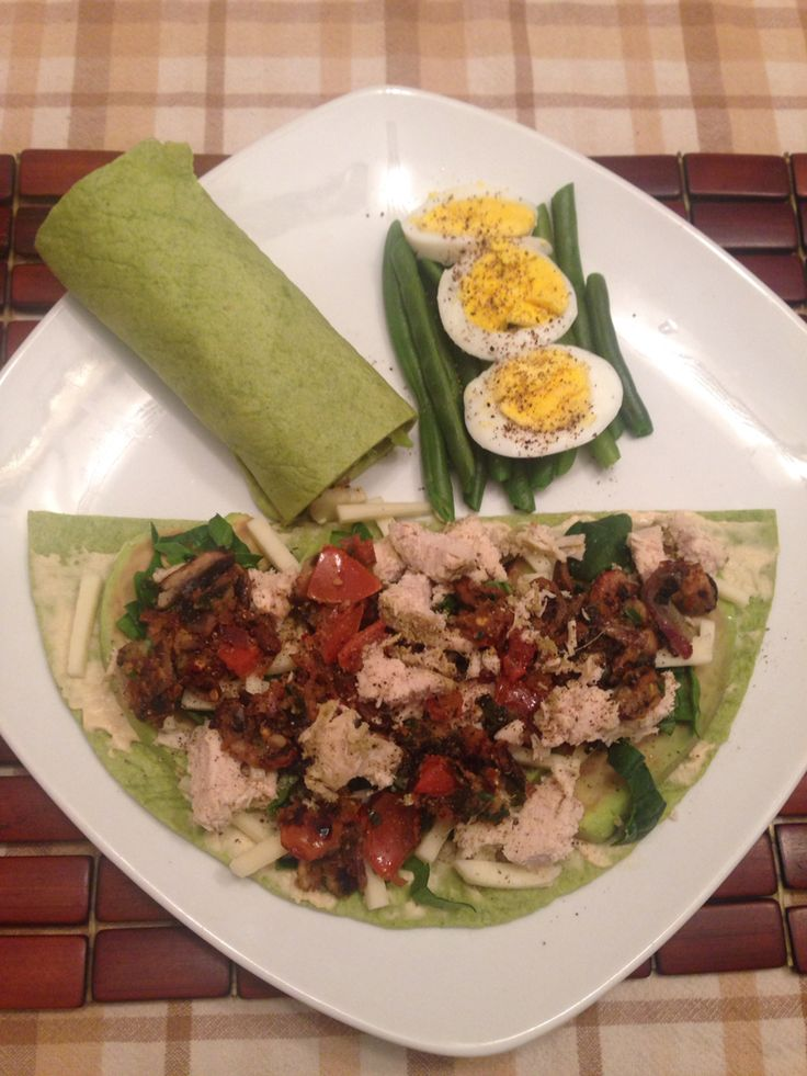 Spinach Tortillas - Hummus - Avocados - cheese - spinach leafs - marinated chicken breast (can use tofu for vegetarians) - roasted together with a table spoon of coconut oil (mushrooms, carrots, tomatoes, red onions, african spice & hers) - Steamed green beans and boiled eggs  - Enjoy