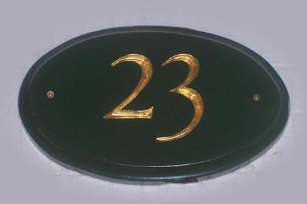 Hand carved.  High Density Urethane.  Hand painted and gold leafed.  Created by Jackie Shields, www.saugeensignworks.com