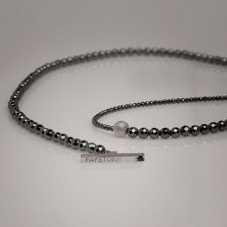 Platinum plated Sterling Silver State of the art clasp with one Sapphire | www.faystone.com