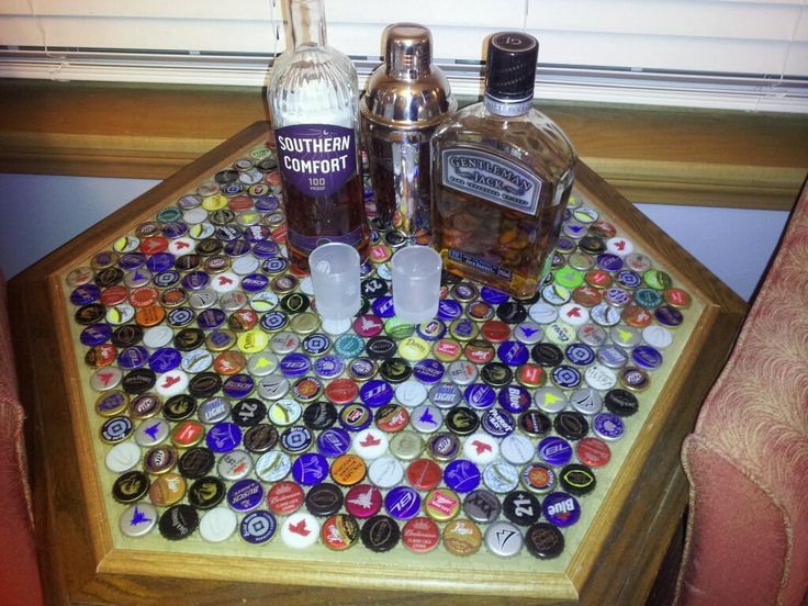 DIY Beer Cap Table for man cave or basement bar. I'm thinking poker chips under glass for poker table-really confusing when drinking!