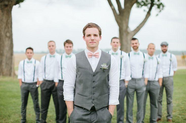 groom with pink bow tie...his groomsmen in teal