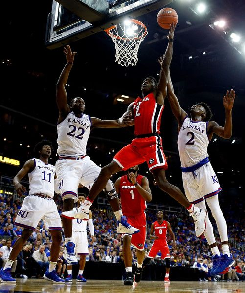Jordan Harris #2 of the Georgia Bulldogs shoots as Josh Jackson #11, Dwight Coleby #22, and Lagerald Vick #2 of the Kansas Jayhawks defend during the CBE Hall of Fame Classic game at the Sprint Center on November 22, 2016 in Kansas City, Missouri.