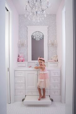 Perfect for a little princess! (Notice the pull-out step under the cabinet that she is standing on).