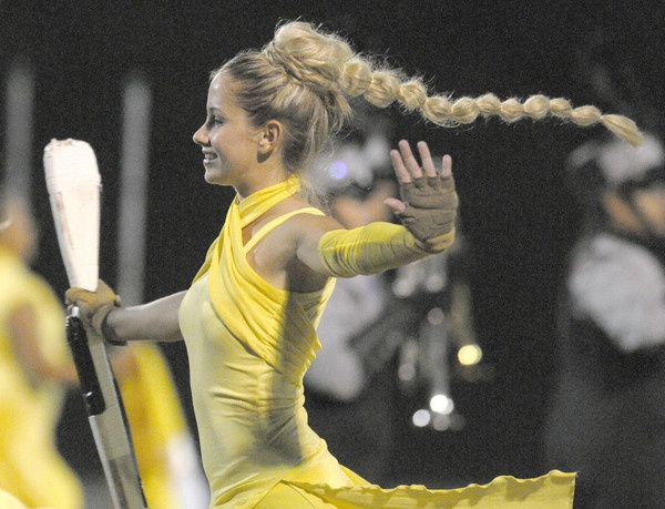 A member of the Timber Creek color guard swings her #hair while performing with the marching band during halftime of a high school football game at Cypress Creek H.S. in Orlando, Fla., Friday, Nov. 12, 2010.