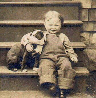 Cute dog, cute kid.