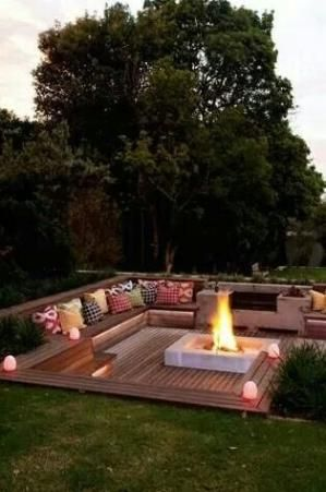 Outdoor sitting area with firepit by shauna