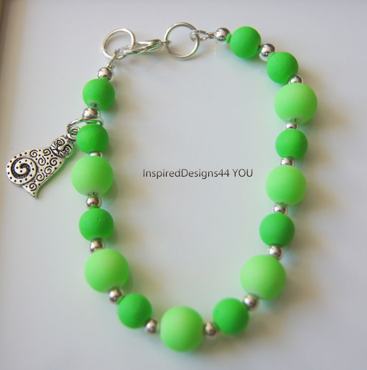 Beautiful lime green neon bracelet. Women's small. Playful sterling silver cat charm graces they delightful piece.  https://www.etsy.com/listing/181759383/neon-lime-green-sterling-silver-bracelet?ref=shop_home_active_3