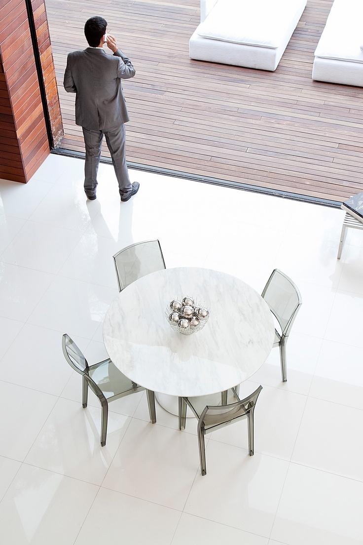 Perhaps quartz to match kitchen counter tulip round for Quartz top dining table