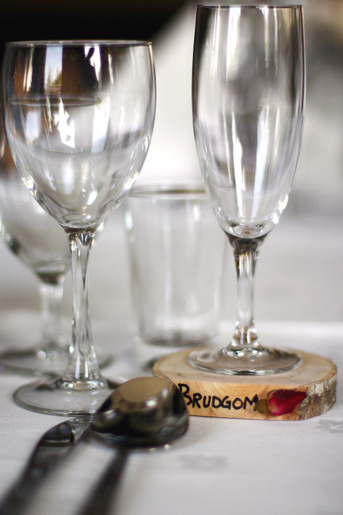 Wedding! Individual placement cards by the table, double as personal coasters.  decorated with rustic wood and dried pink rosebuds.