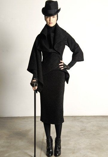 Above is a garment from Alexander McQueen's 2009 Pre-Fall Collection. This collection incorporates styles from the 19th century. It can be said that inspiration of the 2 –piece garment was drawn primarily from 19th century menswear (waistcoat and trousers).  The garment also has a sheath silhouette that was adopted by women during the second bustle period. Additionally, the look was accessorized with a walking stick and a bowler hat that was commonly worn during the Victorian era.
