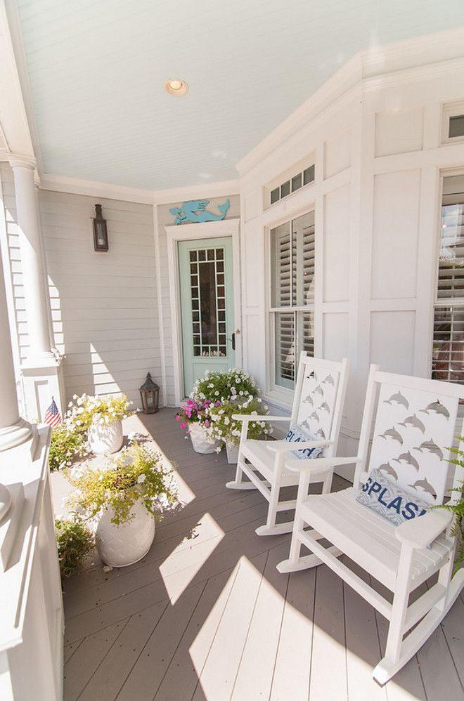 Front Porch with blue ceiling and turquoise front door. Porch ceiling paint color is Glidden Warm Breeze. Strickland Homes