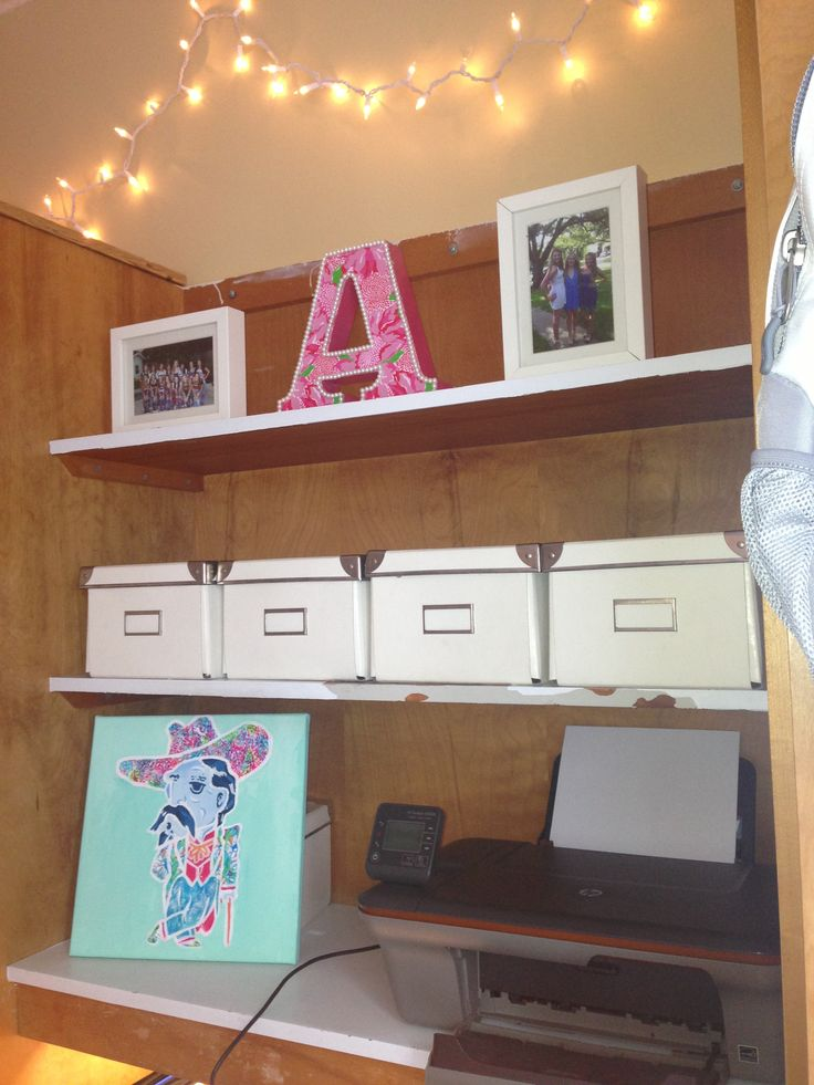 "My desk at Ole Miss!! Ikea boxes. Frames from ikea. The ""A"" my roommate made from Lily Pulitzer wrapping paper."