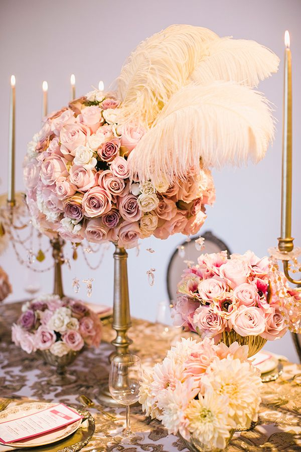 Tall pink rose and feather centerpiece for a glam wedding
