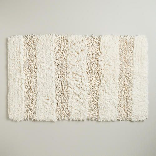 One of my favorite discoveries at WorldMarket.com: Ivory Hi-Low Shag Bath Mat // sew these together to make an area rug?