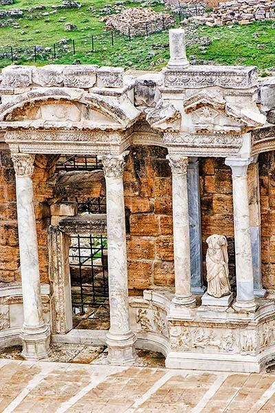 Come for the Pamukkale Terraces, stay for the Hierapolis Theatre! This is probably the best ancient theatre in any archaeology site in Turkey. Enter through the gate and you will be blown away! This theatre not only had 15,000 semi-circular seats but a complete building as well.  #Hierapolis #Turkey #travel #photography