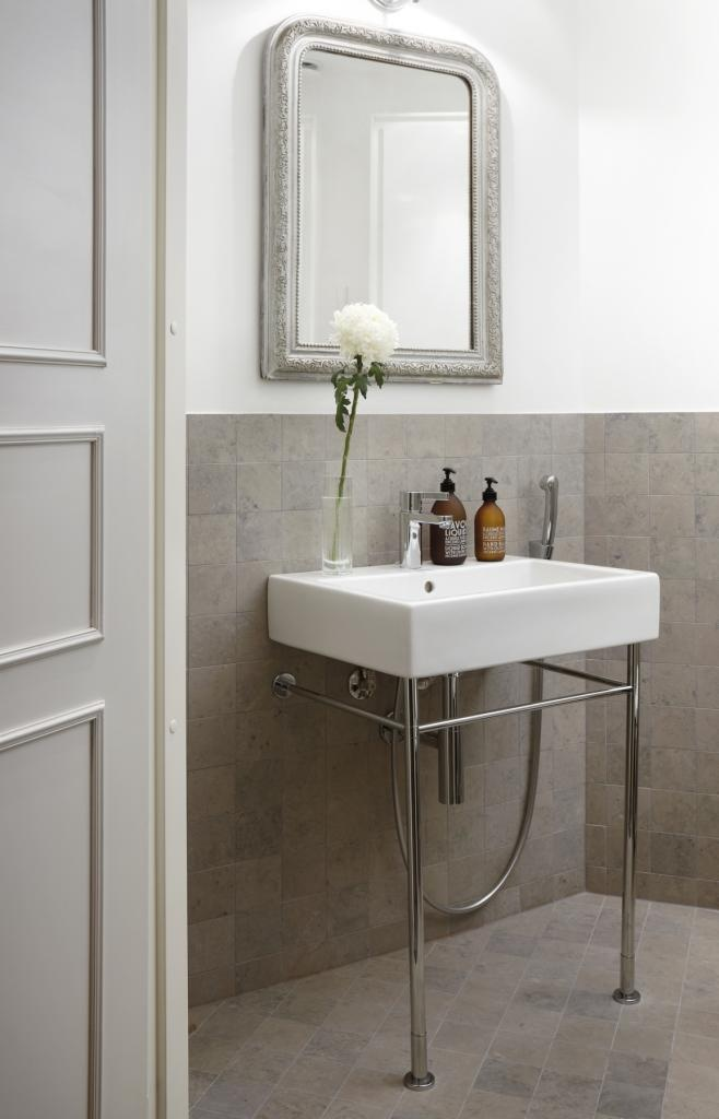 Bathroom has Tulikivi Atazul limestone tiles that match well with grey, mud and brownish colors. Tulikivi's media