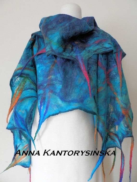Felted scarf MARINA with dreads. It will make you younger and give you endless energy of the ocean. Shades of turquoise pervade deep navy blue. It is made of high quality Australian merino wool decorated with silk fibers. Felted scarf is pleasantly warm, light, soft to the touch perfectly decorate your clothes.  L 195 cm x W 65 cm (77 in x 26in) (without dreads)  This handmade scarf is an eco fashion product. It means it is 100% eco-friendly. Luxury is natural!  Felt does not require…