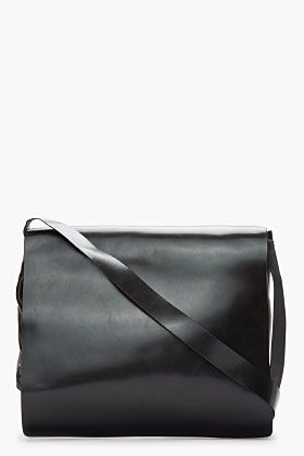 ANN DEMEULEMEESTER Black Leather Messenger Bag. Classic understated elegance.