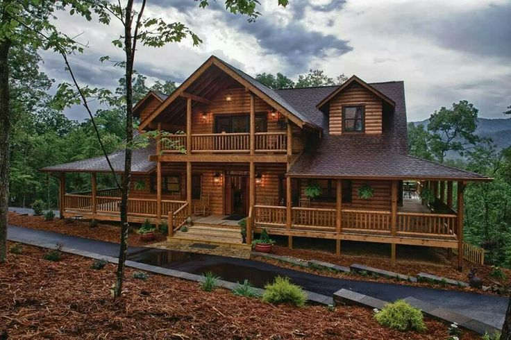 The wraparound porch adds living space for Log cabin homes with wrap around porch