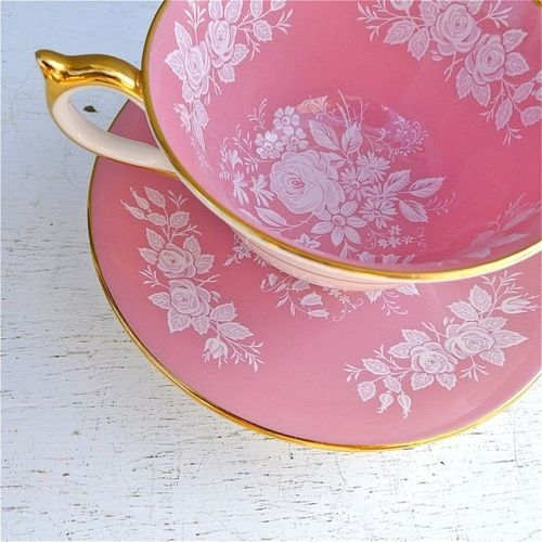 very sweet light pink , gold, and white rose tea cup