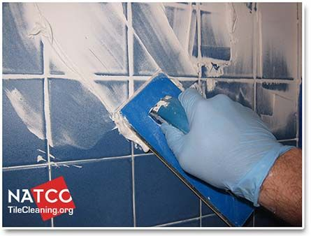 applying shower grout with a grout float