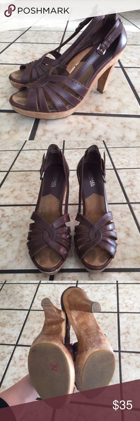 Michael by Michael kors brown heeled sandals Sz 9 Gently used Michael by Michael kors strappy brown heels sandals with a wooden heel. ~5inch heel with a ~1 inch platform MICHAEL Michael Kors Shoes Heels