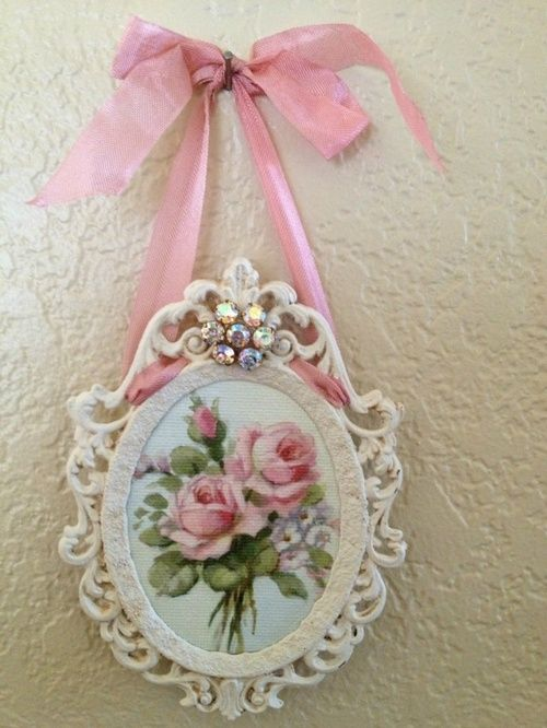 I see these little brass Italian frames for cheap. Paint white, replace picture add a vintage piece of jewelry and ribbon. Wha-la!