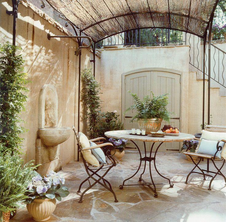 Mediterranean Patio With Fountain, Exterior Awning, Trellis, Barn Door,  Exterior Stone Floors
