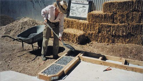 Strawbale Wall Construction A Photo Of A Worker Using A