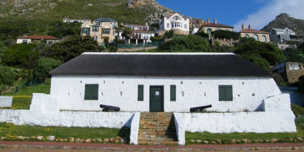 """Het Posthuys (""""the post house"""") in Muizenberg - Cape Town. Built in the 1670s, Het Posthuys is the oldest standing building on the False Bay coastline. The Anglo-American Corporation restored the building in the early 1980s and it was reopened as a museum. One of the original floor stones still has a series of boat-shaped grooves caused by an ochre-grinding stone, probably used by the San or Khoi inhabitants of the area. (+27 (0)21 788 7972) #HetPosthuys #Muizenberg #HetPosthuys"""