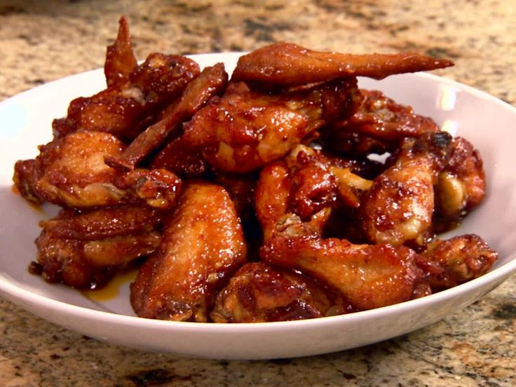 Pat's Spicy Peach Hot Wings from FoodNetwork.com    I usually use equal amts of preserves and Hot Sauce (Frank's Red Hot sauce) - you'll love this recipe, it's a keeper!