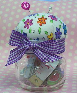 baby food jar pincusion. pins on top, sewing things in bottom.