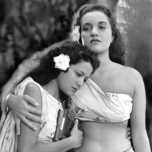 "Movita Castaneda, left, as Tehani and Mamo Clark as Maimiti in 1935's ""Mutiny on the Bounty."" Castaneda, who later became Marlon Brando's second wife, has died at the age of 98. 2015"