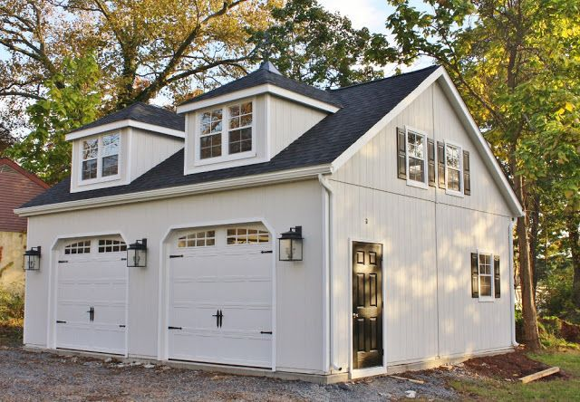 This gorgeous carriage house was built by a group of Amish carpenters. It definitely beats most of the plain garages folks have these days!