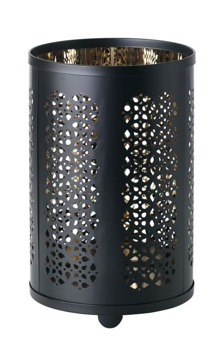 Warm candlelight shines decoratively through the lace pattern of the STABBIG lantern.