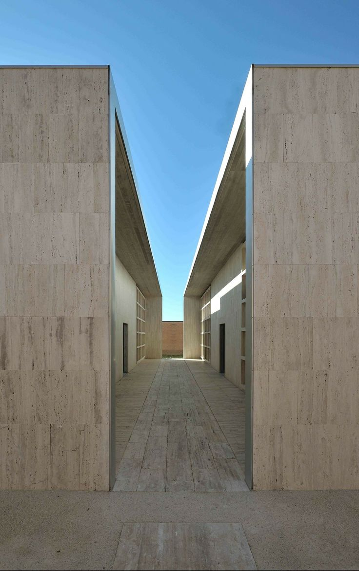 Italian architect Andrea Dragoni has extended a cemetery in an ancient Italian town by adding rows of monumental travertine walls with publi...