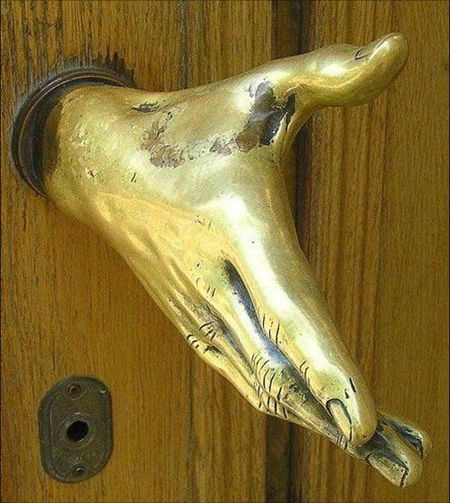 Door knob that is in the shape of a hand!  All are welcome. Although what is someone comes who is not welcome?