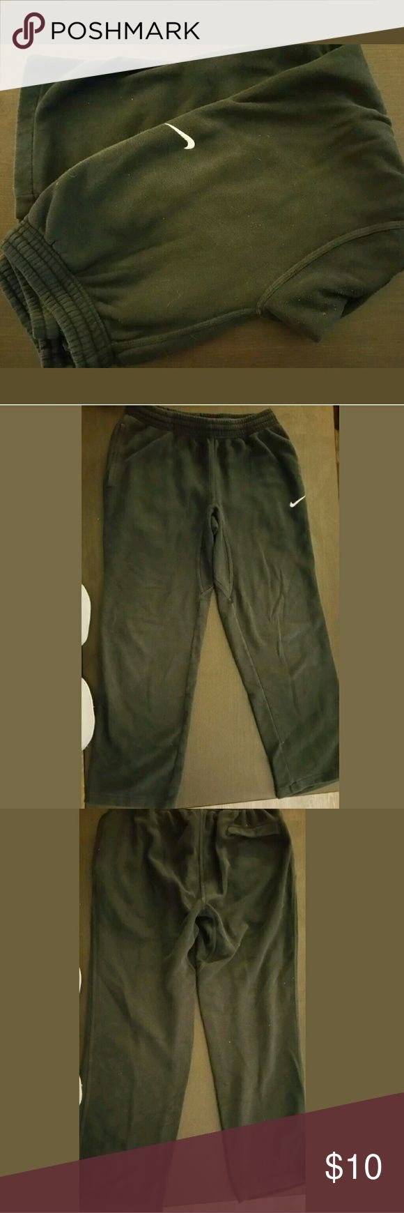 Nike Club Swoosh Fleece Sweatpants Medium Black Nike Club Swoosh Men's Fleece Sweatpants Pants Classic Fit, Medium - Black  Fleece pant with side pockets. Drawcord at waistband for adjustability and open bottom hem. Embroidered Swoosh  No stains or tears.   Have a great day!  Tracy Nike Pants Sweatpants & Joggers