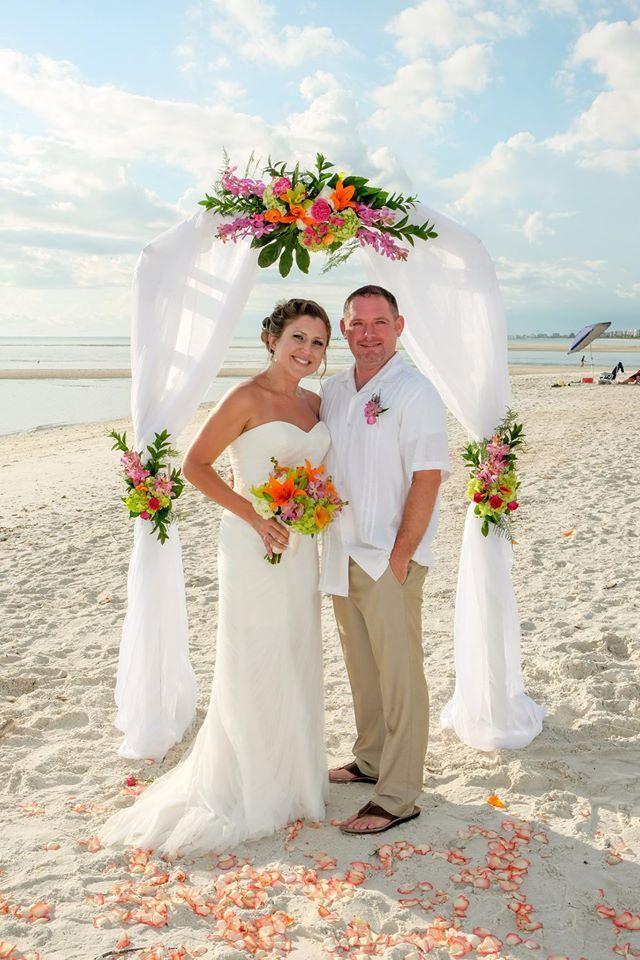 White wooden arch, wedding arch, wedding flowers, tropical arrangements, bridal bouquet, bride and groom, Naples beach wedding