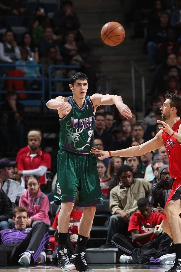 MILWAUKEE, WI - MARCH 2: Ersan Ilyasova #7 of the Milwaukee Bucks passes the ball against Andrea Bargnani #7 of the Toronto Raptors on March 2, 2013 at the BMO Harris Bradley Center in Milwaukee, Wisconsin.