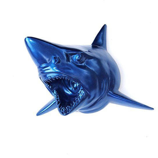 Faux Taxidermy Shark Wall Decor   dun dun, dun dun, dundundundun! JAWS!    This Blue shark is sure to be a conversation piece in your home!  It is hand painted in Metallic Blue  paint, which will certainly attract your eye's attention.  He is coming off the wall at an angle, ready to attack!    **Each piece is custom made to order, so please allow 2-4 business days for production.  If you need the item sooner, message us and we will try our best to accommodate your needs.   MEASUREMENTS:...