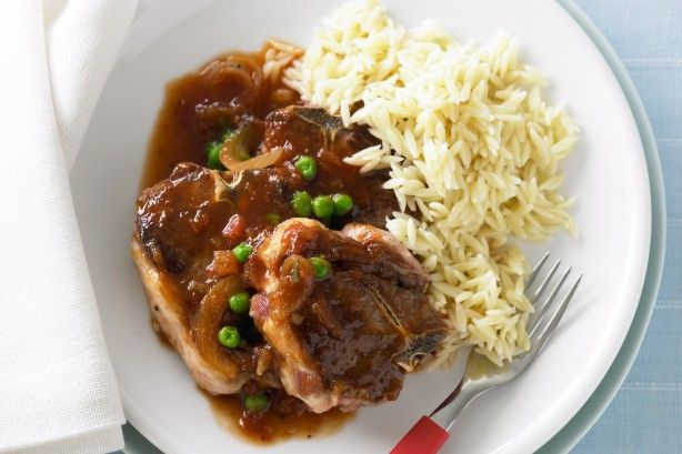 Lamb chops in a fruit chutney and wine sauce is served with peas on a bed of risoni pasta.